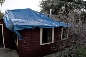 This should be a picture of a tarp covering a roof.